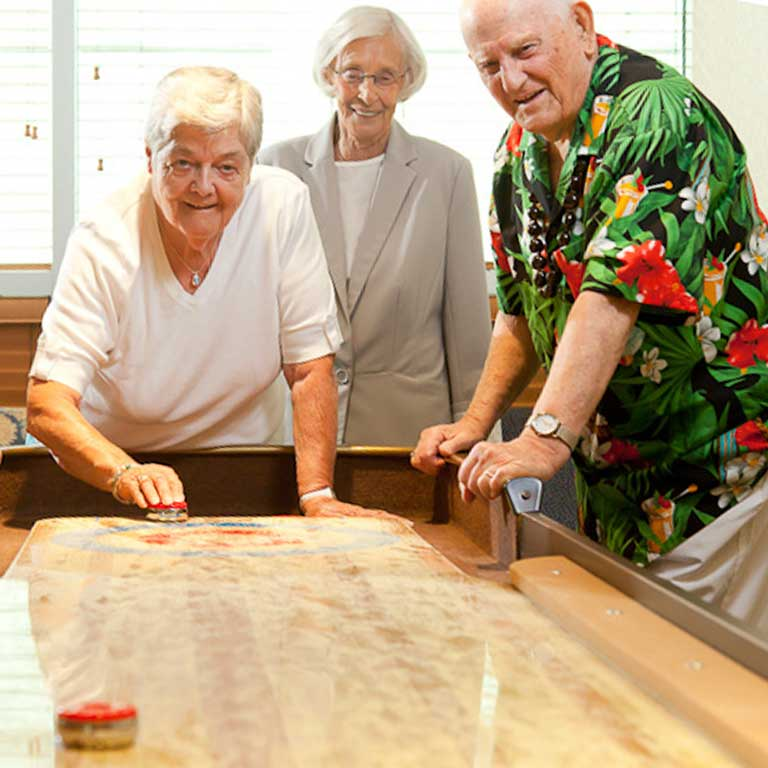 VRS Lakeside Gardens Seniors Community Our Story our values happy senior residents playing shuffleboard