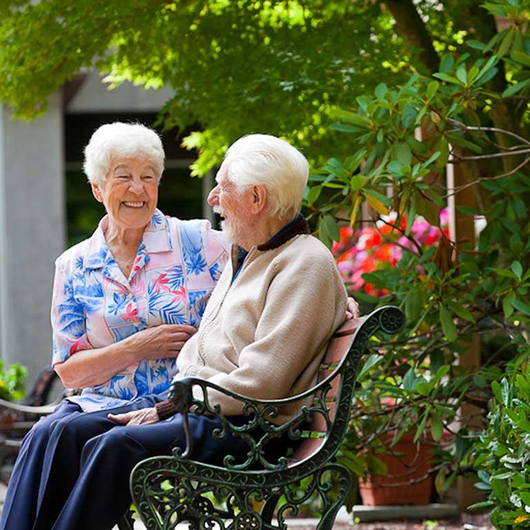 VRS Lakeside Gardens Seniors Community Our Story our vision happy senior residents sitting in garden